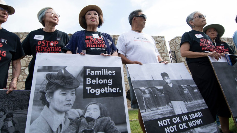FORT SILL, OK - JUNE 22: Japanese Americans pose with photos of themselves taken while they were in relocation camps in WWII, during a press conference on June 22, 2019 in Lawton, Oklahoma to protest the military base, Fort Sill, being used to house 1,400 migrant children. Fort Still has a history of housing those seeking asylum as well as Japanese Americans were imprisoned during WWII and Native Americans were housed there.