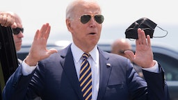 US President Joe Biden answers a question from the press as he holds a mask upon arrival on Air Force One at Lehigh Valley International Airport in Allentown, Pennsylvania, July 28, 2021, as he travels to speak on the economy. (Photo by SAUL LOEB / AFP) (Photo by SAUL LOEB/AFP via Getty Images)