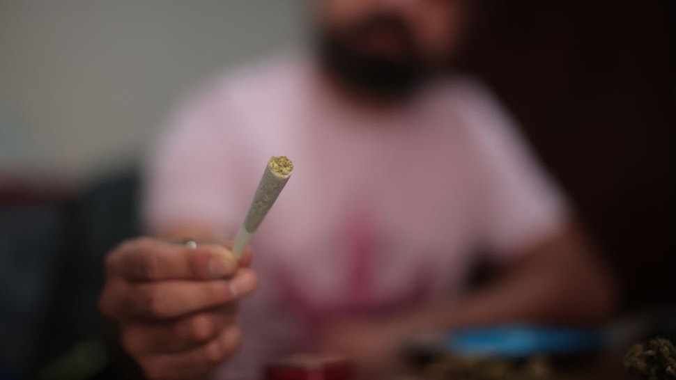 MEXICO CITY, MEXICO - MARCH 13: Cesar, 36, holds a marijuana joint on March 13, 2021 in Mexico City, Mexico.