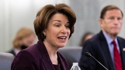 WASHINGTON, DC - APRIL 21: Senator Amy Klobuchar, D-MN, speaks during a Senate Commerce, Science, and Transportation Committee hearing on the nomination of Former Senator Bill Nelson, FL, to be NASA administrator, on Capitol Hill on April 21, 2021 in Washington, DC. Nelson was a senator representing Florida from 2001-2019.