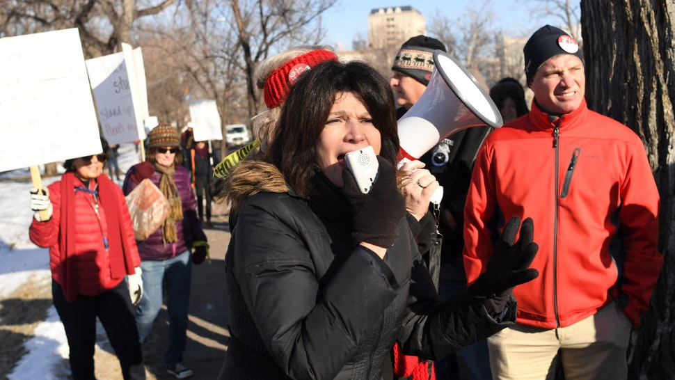 DENVER CO - FEBRUARY 11: Lily Eskelsen García, President of the National Education Association, joined Denver Public School teachers as they walk the picket lines outside West High School during day one of a strike for Denver Public School teachers on February 11, 2019 in Denver, Colorado.