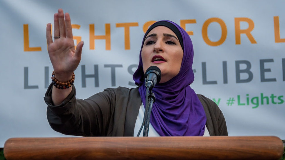 FOLEY SQUARE, NEW YORK, UNITED STATES - 2019/07/12: Activist Linda Sarsour - Thousands of advocates, activists and community members flooded the streets at Foley Square, across from the Immigration and Customs Enforcement (ICE) New York Field Office to join New Sanctuary Coalition and The New York Immigration Coalition at the Lights for Liberty vigil, deemed one of the largest solidarity actions in history with over 750 vigils across 5 continents. A light was lit for all those held in U.S. detention camps and to bring light to the darkness of the Trump administration's horrific policies. (Photo by Erik McGregor/LightRocket via Getty Images)