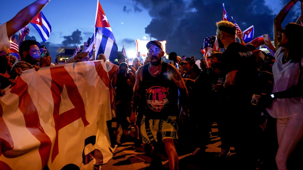 MIAMI, FLORIDA - JULY 11: People rally near Versailles, a Cuban restaurant in the Little Havana neighborhood, in support of the protests in Cuba on July 11, 2021 in Miami, Florida. Thousands took to the streets across Cuba to protest pandemic restrictions, the pace of Covid-19 vaccinations and the Cuban government.