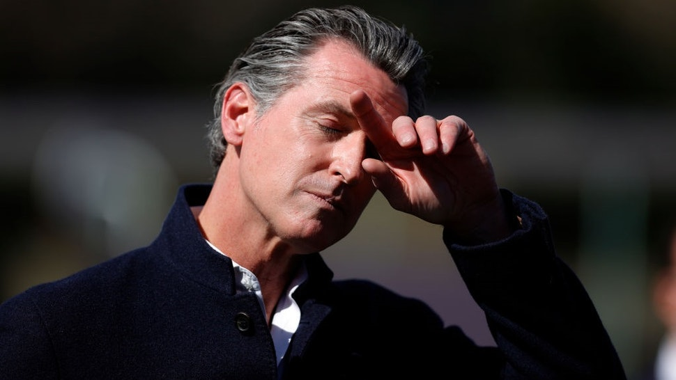 PALO ALTO, CALIFORNIA - MARCH 02: California Gov. Gavin Newsom pauses during a news conference after touring Barron Park Elementary School on March 02, 2021 in Palo Alto, California.