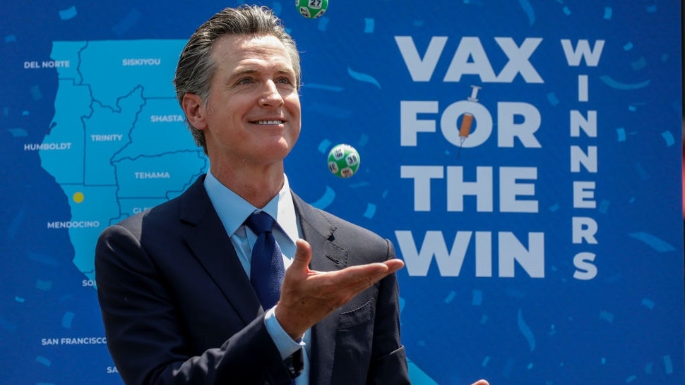 Universal City, CA - June 15: Gov. Gavin Newsom juggles numbered balls used in a lottery-style give away, following the conclusion of a press conference celebrating Californias full reopening, marking the end of pandemic-era restrictions like masks, social distancing and most capacity restrictions, at Universal Studios, in Universal City, CA, Tuesday, June 15, 2021.