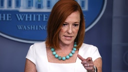 WASHINGTON, DC - JULY 26: White House Press Secretary Jen Psaki gestures as she speaks at a daily press briefing in the James Brady Press Briefing Room of the White House on July 26, 2021 in Washington, DC. Psaki reiterated the administrations confidence in the Center for Disease Control (CDC) on advising next steps that should be taken as Coronavirus cases continue to rise in the United States.