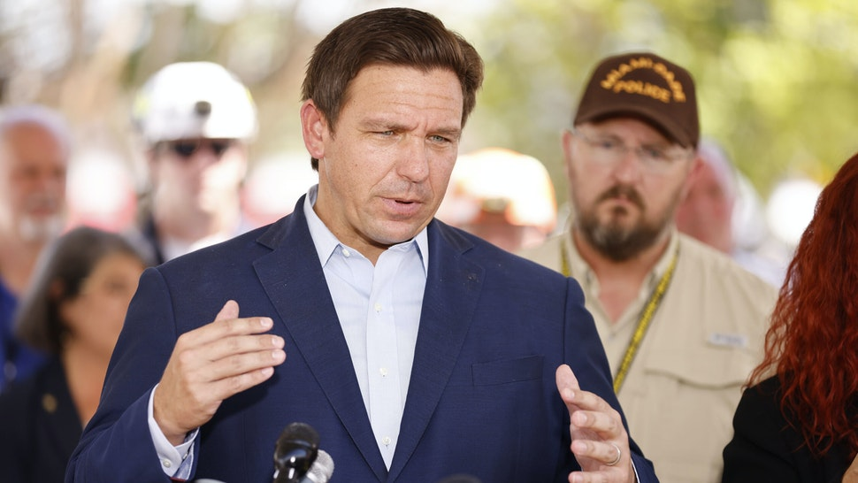 SURFSIDE, FLORIDA - JULY 03: Florida Gov. Ron DeSantis speaks to the media about the 12-story Champlain Towers South condo building that partially collapsed on July 03, 2021 in Surfside, Florida. Over one hundred people are being reported as missing as the search-and-rescue effort continues.