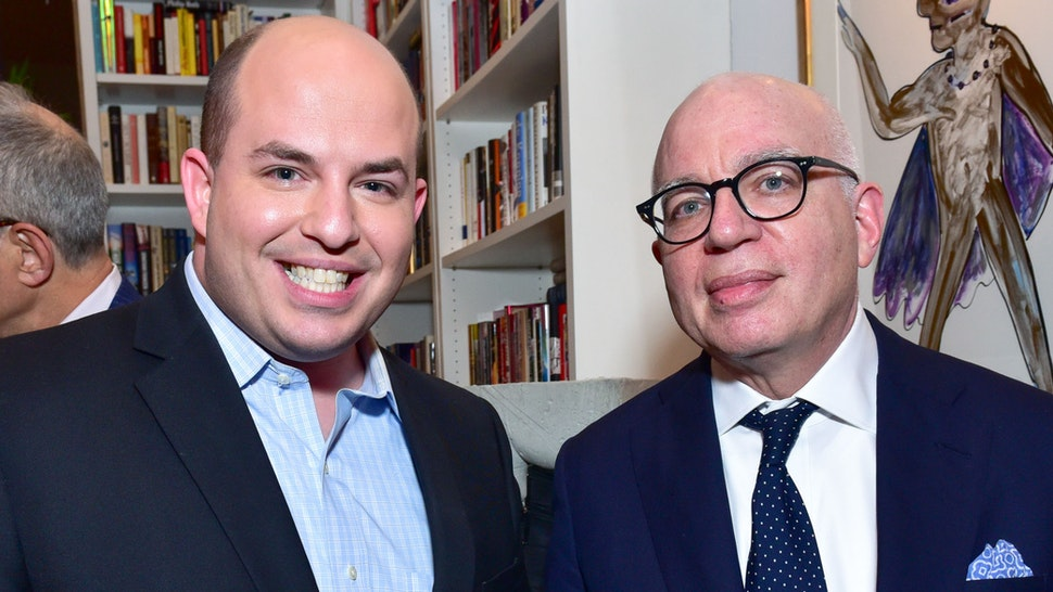 """NEW YORK, NY - JANUARY 17: Brian Stelter and Author Michael Wolff attend publisher Henry Holt toasts Michael Wolff's """"Fire and Fury"""" at Private Residence on January 17, 2018 in New York City."""