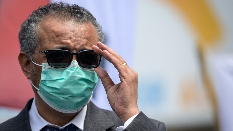 World Health Organization (WHO) Director-General Tedros Adhanom Ghebreyesus adjusts his glasses during a meeting with Doctors for Extinction Rebellion in front of the WHO headquarters during a protest on the sideline of the WHO's World Health Assembly in Geneva on May 29, 2021. - Hundreds of health workers marched to the WHO demanding that authorities in all countries recognise and act to counter the health risks of climate change.