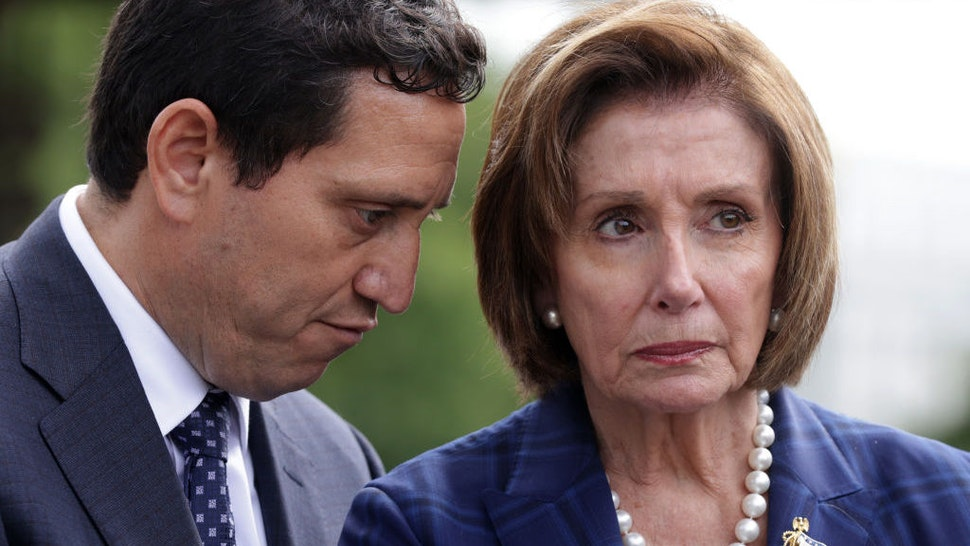 WASHINGTON, DC - JUNE 15: U.S. Speaker of the House Rep. Nancy Pelosi (D-CA) (R) listens to Texas State House Rep. Trey Martinez Fischer (D-San Antonio) (L) during a news conference with Democratic House members from Texas and Texas Democratic state legislators in front of the U.S. Capitol June 15, 2021 in Washington, DC. The Texas Democratic state House Representatives who staged a walk-out and killed the legislation, Senate Bill 7, and their State Senate counterparts were on Capitol Hill to meet with Democratic Senate and House leaders. (Photo by Alex Wong/Getty Images)