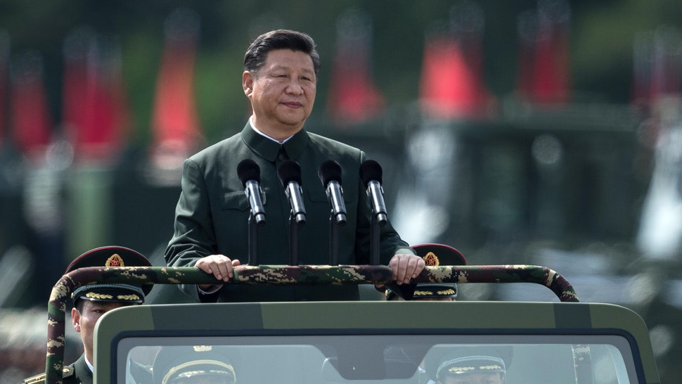 China's President Xi Jinping inspects People's Liberation Army soldiers at a barracks in Hong Kong on June 30, 2017. - Tanks, missile launchers and chanting troops greeted Xi in a potent display of Chinese military might as part of his landmark visit to politically divided Hong Kong.