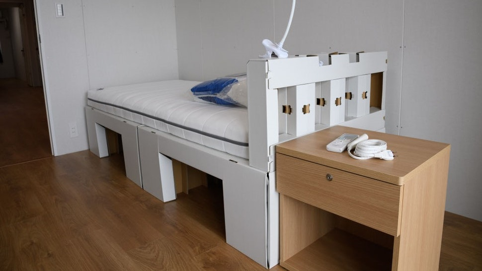 A recyclable cardboard bed and mattress inside a residential unit for athletes during a media tour at the Olympic and Paralympic Village for the Tokyo 2020 Games, constructed in the Harumi waterfront district of Tokyo, Japan, on Sunday, June 20, 2021. Athletes and officials at the Olympics will be subject to a range of penalties should they break virus protocols during the Tokyo Games. Photographer: