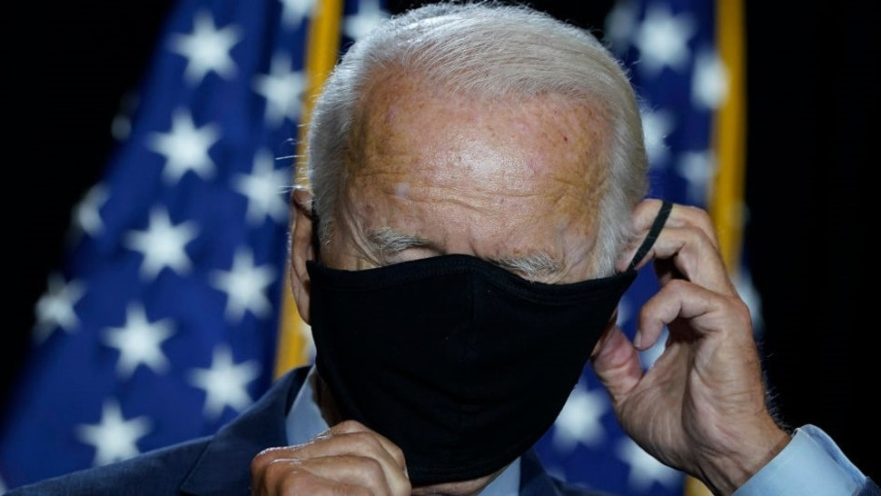 WILMINGTON, DE - AUGUST 13: Presumptive Democratic presidential nominee former Vice President Joe Biden puts his mask back on after delivering remarks following a coronavirus briefing with health experts at the Hotel DuPont on August 13, 2020 in Wilmington, Delaware. Harris is the first Black woman and first person of Indian descent to be a presumptive nominee on a presidential ticket by a major party in U.S. history. (Photo by