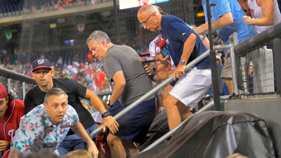 WASHINGTON, DC- JULY 17: Fans rush to evacuate after hearing during a game between a the San Diego Padres and the Washington Nationals at Nationals Park in Washington, DC on July 17, 2021. (Photo by