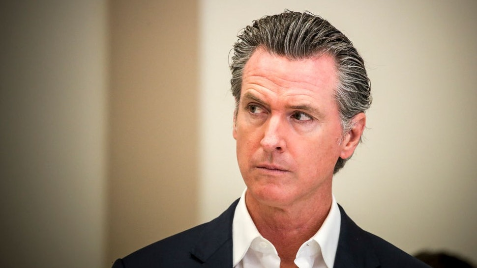 Bell Gardens, CA - July 14: Gov. Gavin Newsom presents the nation's largest rent relief program as Part of the $100 Billion California Comeback Plan. The California Comeback Plan's $5.2 billion investment helps low-income Californians cover 100 percent of their back rent and rent for several months into the future. Press conference was held at Ross Hall at Veterans Park on Wednesday, July 14, 2021 in Bell Gardens, CA. (