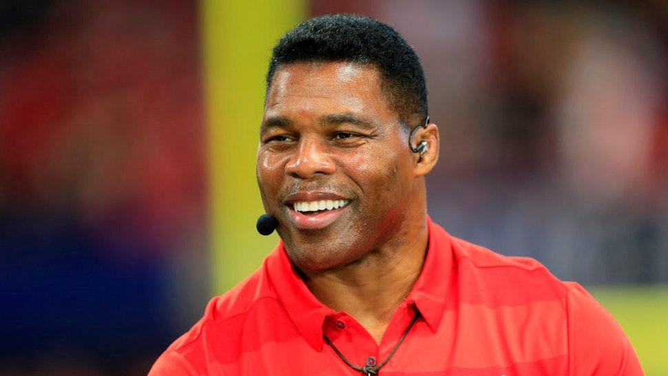 ATLANTA, GA - DECEMBER 07: Former UGA football great Herschel Walker was a guest on the pregame show before the SEC Championship Game between the UGA Bulldogs and the LSU Tigers on December 7, 2019 at the Mercedes-Benz Stadium in Atlanta, Georgia. (Photo by