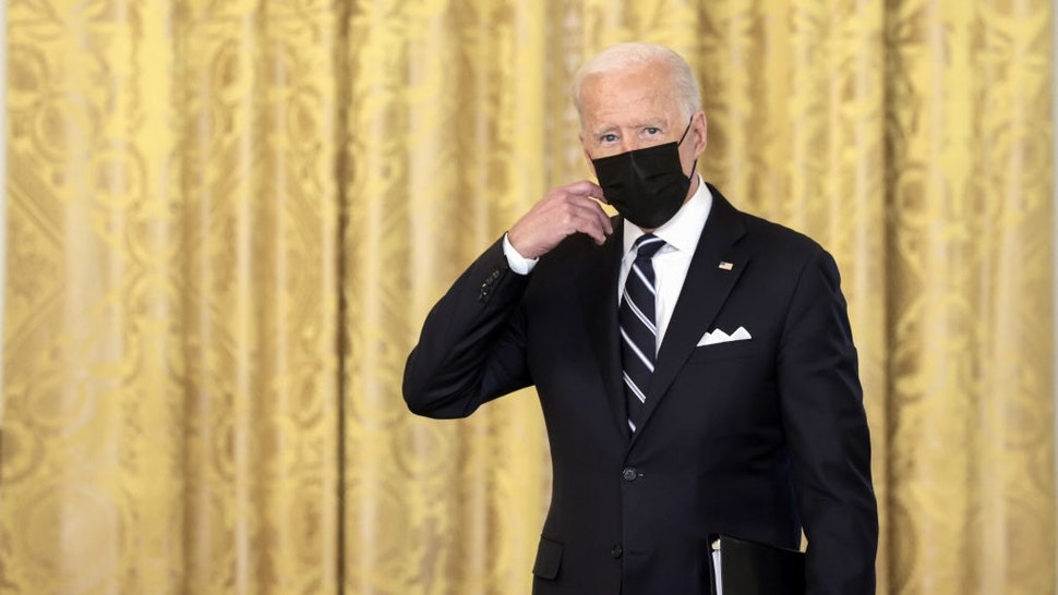 President Biden Delivers Remarks On Administration's Covid-19 Response WASHINGTON, DC - AUGUST 18: U.S. President Joe Biden removes his face mask as he arrives to deliver remarks on the COVID-19 response and the vaccination program in the East Room of the White House on August 18, 2021 in Washington, DC. During his remarks, President Biden announced that he is ordering the United States Department of Health and Human Services to require nursing homes to have vaccinated staff in order for them to receive Medicare and Medicaid funding. The President also announced that Americans would be able to receive a third booster shot against Covid-19. (Photo by Anna Moneymaker/Getty Images) Anna Moneymaker / Staff via Getty Images