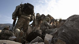 U.S. Forces Battle Taliban In Kunar Province KORENGAL VALLEY, AFGHANISTAN - OCTOBER 28: U.S. Army soldiers take firing positions after climbing a mountain October 28, 2008 in the Korengal Valley in eastern Afghanistan. American forces from 2nd Platoon Viper Company of the 1-26 Infantry occupied a strategic mountaintop, and were attacked by Taliban insurgents. No Americans were injured in the ensuing firefight and Taliban casualties were unknown. The Korengal Valley in Kunar Province is the site of some of the heaviest fighting of the Afghan war. (Photo by John Moore/Staff/Getty Images)