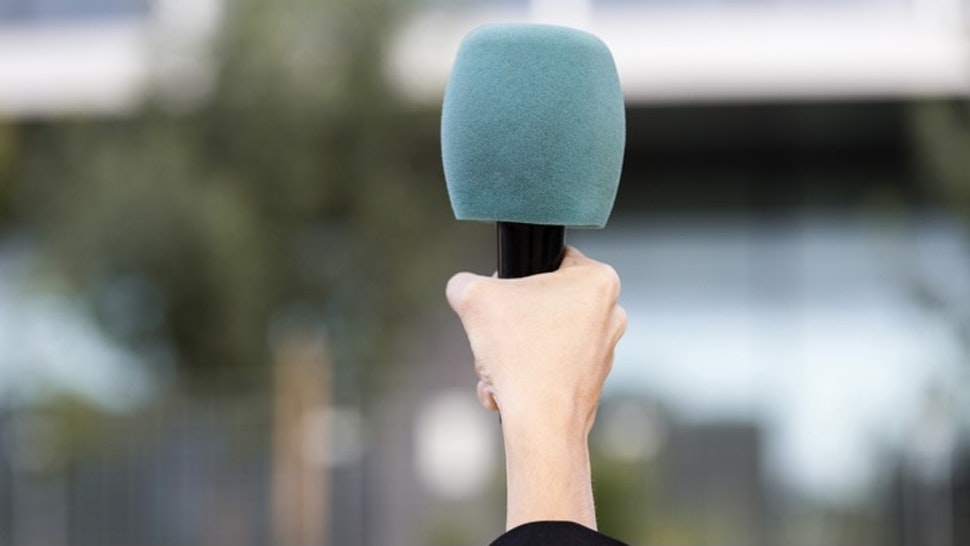 Close-up of a hand of a journalist holding a microphone latex gloves holding a microphone with plastic protection- stock photo - stock photo Close-up of a hand of a journalist holding a microphone latex gloves holding a microphone with plastic protection Manu Vega via Getty Images