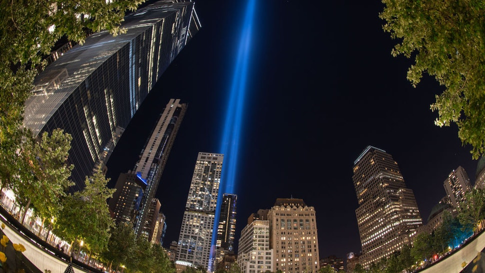 MANHATTAN, NEW YORK, UNITED STATES - 2020/09/11: (EDITORS NOTE: Image taken with fish eye lens) View of Tribute of Light illuminates skies above the south reflecting pool of the National September 11 Memorial and Museum on 19th anniversary of terror attack. The twin lights represent the Twin Towers which were destroyed during terror attack in 2001.