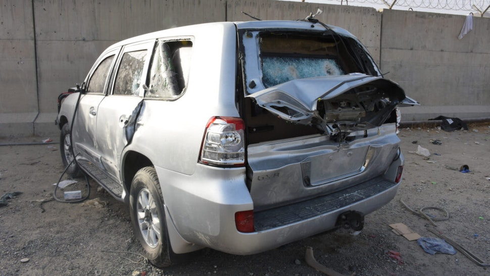KABUL, AFGHANISTAN - AUGUST 20: Destroyed vehicles are seen at the entrance of the airport in Kabul, Afghanistan on August 20, 2021. People who wanted to leave the country had to leave their vehicles at the international airport checkpoint. Vehicles damaged by those who could not enter the airport with the hope of evacuation turned into a car junkyard.