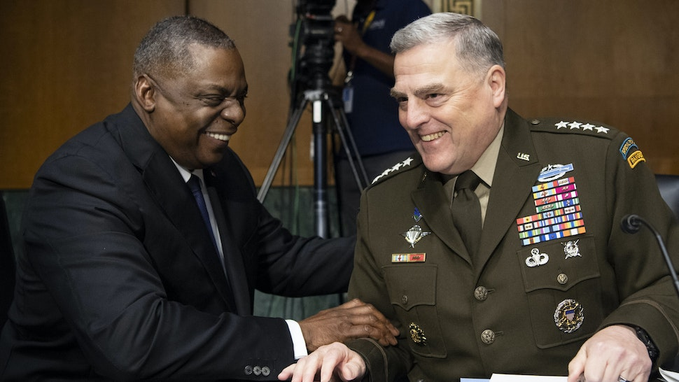 """WASHINGTON, DC - JUNE 17: Secretary of Defense Lloyd Austin, left, and Chairman of the Joint Chiefs of Staff Gen. Mark Milley talk before the start of the Senate Appropriations Committee hearing on """"A Review of the FY2022 Department of Defense Budget Request' on June 17, 2021 in Washington, DC. The hearings are to examine proposed budget estimates and justification for fiscal year 2022 for the Department of Defense."""