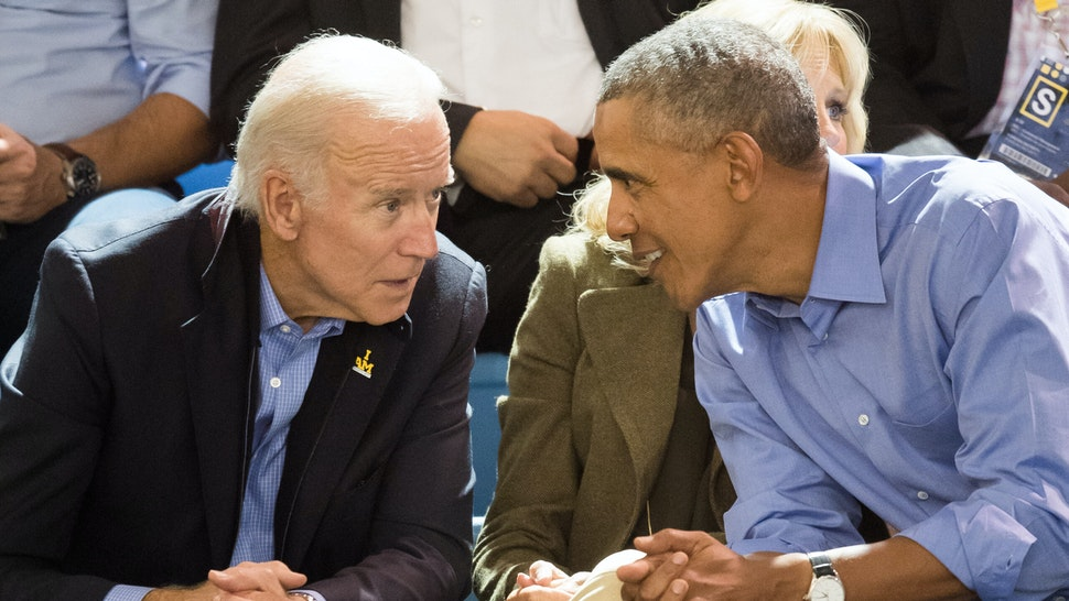 TORONTO, ON - SEPTEMBER 29: Joe Biden and Barack Obama watch the wheelchair basketball on day 7 of the Invictus Games Toronto 2017 on September 29, 2017 in Toronto, Canada. The Games use the power of sport to inspire recovery, support rehabilitation and generate a wider understanding and respect for the Armed Forces.