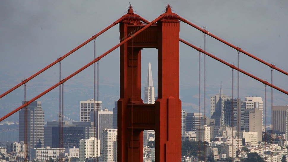 SAUSALITO, CA - JUNE 20: The Transamerica Pyramid building is seen through the north tower of the Golden Gate Bridge June 20, 2007 as seen from Sausalito, California.