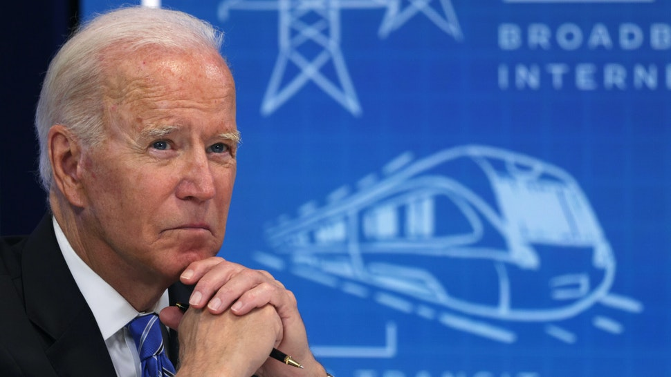 """WASHINGTON, DC - AUGUST 11: U.S. President Joe Biden participates in a virtual meeting on Infrastructure Investment and Jobs Act at South Court Auditorium at Eisenhower Executive Office Building August 11, 2021 in Washington, DC. President Biden met with Governors, Mayors, and other states, local, and tribal officials virtually to discuss """"the importance of the bipartisan Infrastructure Investment and Jobs Act to fix crumbling roads and bridges, make a historic investment in transit, modernize water infrastructure, invest in electric vehicle infrastructure, and expand broadband access to all Americans."""""""