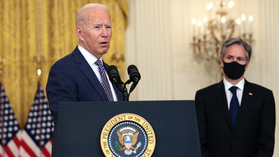WASHINGTON, DC - AUGUST 20: U.S. President Joe Biden gestures to Secretary of State Antony Blinken as he gives remarks on the U.S. military's ongoing evacuation efforts in Afghanistan from the East Room of the White House on August 20, 2021 in Washington, DC. The White House announced earlier that the U.S. has evacuated almost 14,000 people from Afghanistan since the end of July.
