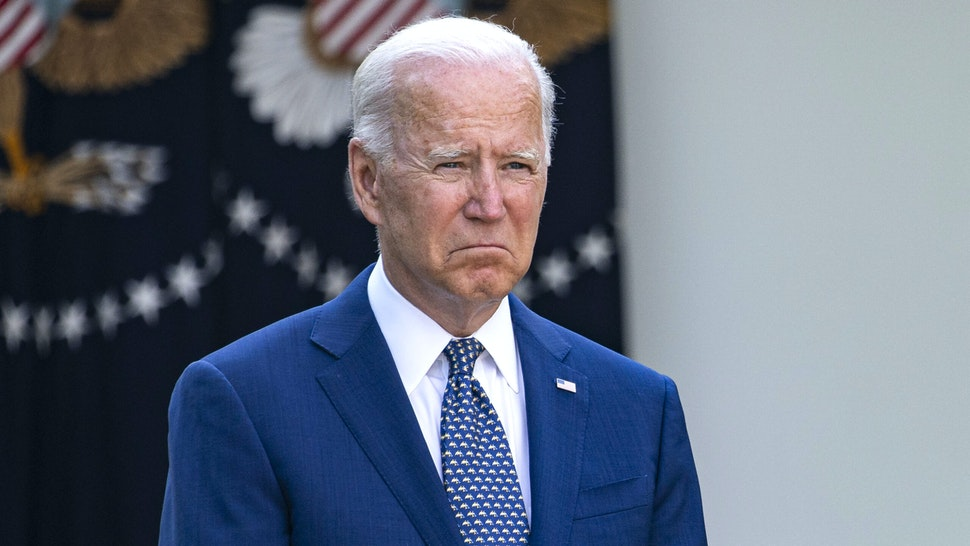 U.S. Vice President Kamala Harris speaks as U.S. President Joe Biden listens during a bill signing ceremony in the Rose Garden of the White House in Washington, D.C., U.S., on Thursday, Aug. 5, 2021. H.R. 3325 is to award Congressional Gold Medals to U.S. Capitol Police and those who protected the Capitol from a mob during the January 6 insurrection of then-President Donald Trump's supporters.