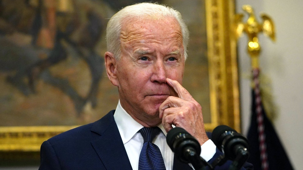 US President Joe Biden speaks during an update on the situation in Afghanistan and the effects of Tropical Storm Henri in the Roosevelt Room of the White House in Washington, DC on August 22, 2021.