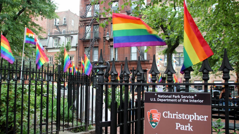 """19 June 2019, US, New York: A fence decorated with rainbow flags at Christopher Park opposite the """"Stonewall Inn"""" in the scene district of Greenwich Village. On a warm night on June 28, exactly 50 years ago, about 200 people, including many homosexuals, celebrate in the popular bar """"Stonewall Inn"""" in Christopher Street in Greenwich Village when eight policemen suddenly arrive. It comes to a melee. The riots are the spark that sets an international movement in motion - and the """"Stonewall Inn"""" becomes the nucleus of the protest movement. (to dpa """"Metropolis in rainbow colors: New York celebrates 50 years of """"Stonewall"""")"""