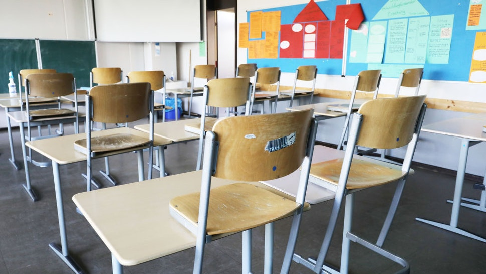 23 April 2021, North Rhine-Westphalia, Kaarst: Chairs are pulled up in an empty classroom at Albert Einstein High School. Photo: Oliver Berg/dpa