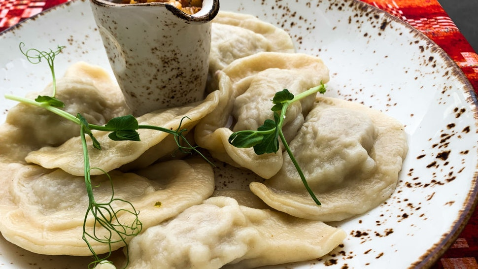 Traditional Lithuanian meal called Kalduny is seen on the restaurant's table in Vilnius, Lithuania on July 27, 2021.