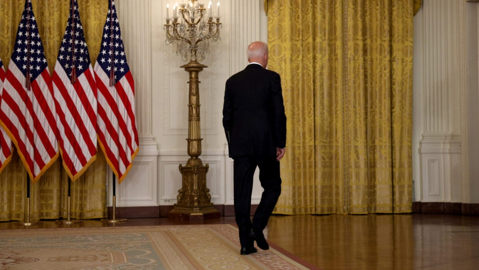 U.S. President Joe Biden walks away without taking questions after delivering remarks on the worsening crisis in Afghanistan from the East Room of the White House August 16, 2021 in Washington, DC.