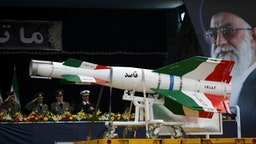 An Iranian surface to surface Ghasedak missile is driven past portraits of Iran's late founder of the Islamic Republic, Ayatollah Ali khamenei (R), during the annual army day military parade on April 17, 2008 in Tehran, Iran.