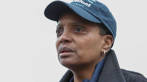 Chicago mayoral candidate Lori Lightfoot speaks to the press outside of the polling place at the Saint Richard Catholic Church in Chicago, Illinois on April 2, 2019. - Chicago residents went to the polls in a runoff election Tuesday to elect the US city's first black female mayor in a historic vote centered on issues of economic equality, race and gun violence. Lightfoot and Toni Preckwinkle, both African-American women, are competing for the top elected post in the city.