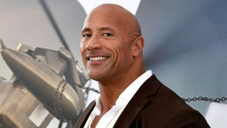 """HOLLYWOOD, CALIFORNIA - JULY 13: Dwayne Johnson arrives at the premiere of Universal Pictures' """"Fast & Furious Presents: Hobbs & Shaw"""" at Dolby Theatre on July 13, 2019 in Hollywood, California. (Photo by Kevin Winter/Getty Images)"""