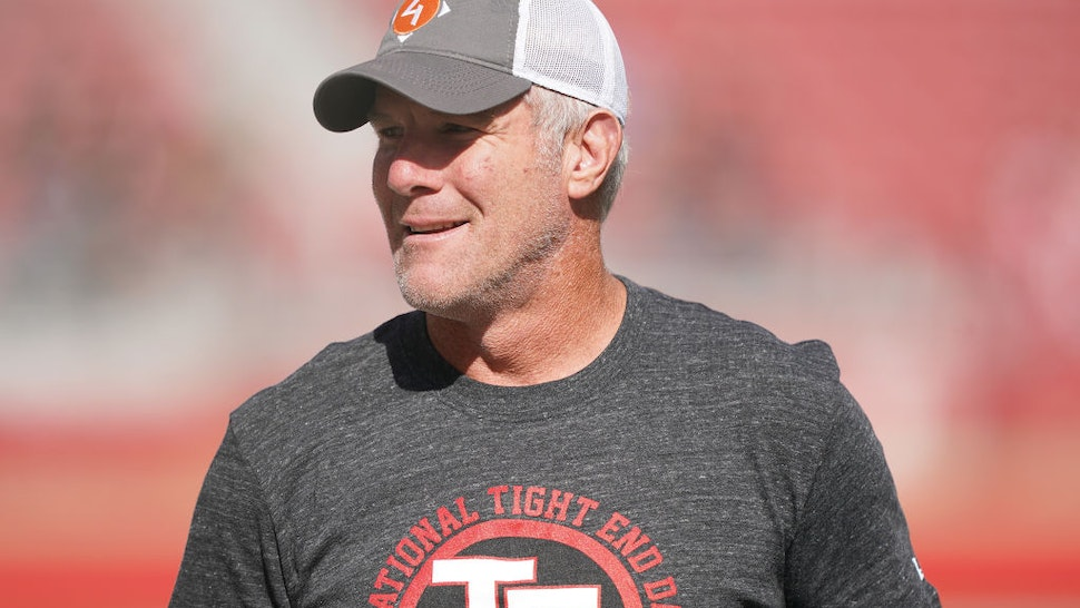 """SANTA CLARA, CALIFORNIA - OCTOBER 27: Former NFL quarterback Brett Favre wears a t-shirt that reads """"National Tight End Day"""" prior to the start of an NFL game between the Carolina Panthers and San Francisco 49ers at Levi's Stadium on October 27, 2019 in Santa Clara, California. (Photo by Thearon W. Henderson/Getty Images)"""