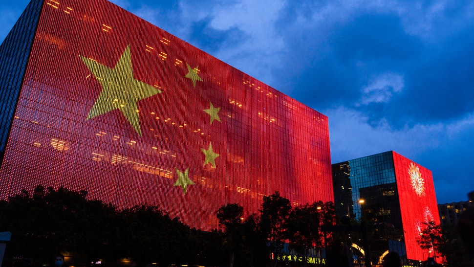 HONG KONG, CHINA - 2021/06/29: Flag of China seen displayed on a building in Tsim Sha Tsui district ahead of July 1st anniversaries of Hong Kong's handover to China and the 100th year of formation of the Chinese Communist Party in Hong Kong, China. (Photo by Chan Long Hei/SOPA Images/LightRocket via Getty Images)