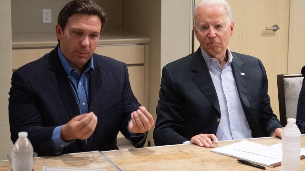US President Joe Biden alongside Florida Governor Ron DeSantis (L) speaks about the collapse of the 12-story Champlain Towers South condo building in Surfside, during a briefing in Miami Beach, Florida, July 1, 2021.