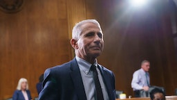 Top infectious disease expert Dr. Anthony Fauci finishes his testimony before the Senate Health, Education, Labor, and Pensions Committee about the status of COVID-19, on Capitol Hill in Washington, Tuesday, July 20, 2021. Cases of COVID-19 have tripled over the past three weeks, and hospitalizations and deaths are rising among unvaccinated people. (AP Photo/J. Scott Applewhite, Pool)