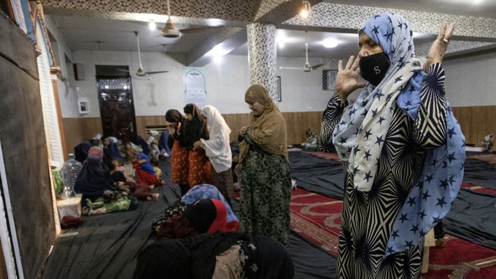 More Displaced Afghans Arrive In Kabul As Taliban Gains Ground KABUL, AFGANISTAN - AUGUST 13 : Displaced Afghan women and children from Kunduz pray at a mosque that is sheltering them on August 13, 2021 in Kabul, Afghanistan. Tensions are high as the Taliban advance on the capital city after taking Herat and the country's second-largest city Kandahar. (Photo by Paula Bronstein /Getty Images) Paula Bronstein / Stringer via Getty Images