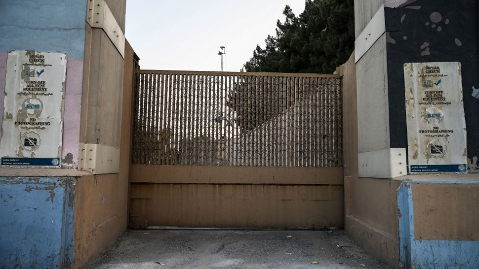 The closed entrance gate of the US embassy is pictured after the US evacuated its personnel in Kabul on August 15, 2021. (Photo by WAKIL KOHSAR / AFP) (Photo by WAKIL KOHSAR/AFP via Getty Images)