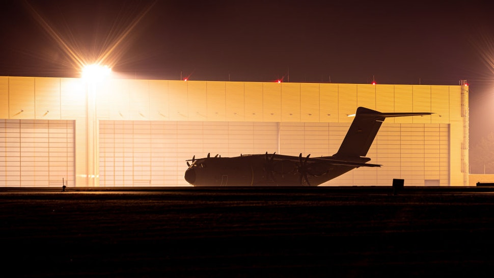 16 August 2021, Lower Saxony, Wunstorf: An Airbus A400M transport aircraft of the German Air Force stands at the Wunstorf air base in the Hanover region this evening. In view of the rapid advance of the Taliban in Afghanistan, the Bundeswehr plans to begin evacuating German citizens and local Afghan forces from Kabul on Monday (16.08.2021). Photo: Moritz Frankenberg/dpa (Photo by Moritz Frankenberg/picture alliance via Getty Images)