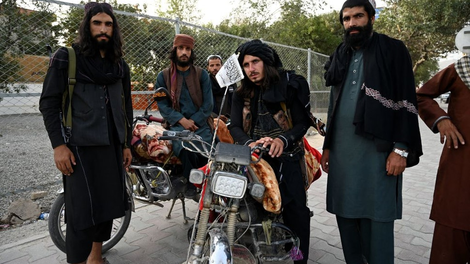 Taliban fighters stand along a road in Kabul on August 18, 2021, after the Taliban's military takeover of Afghanistan. (Photo by Wakil KOHSAR / AFP) (Photo by WAKIL KOHSAR/AFP via Getty Images)