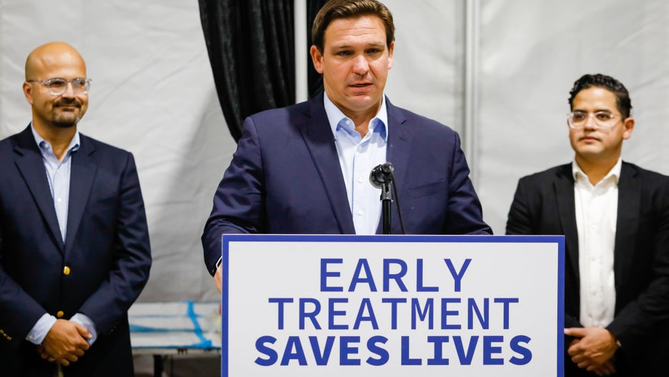 Ron DeSantis, governor of Florida, center, speaks during a news conference at a Regeneron monoclonal antibody clinic in Pembroke Pines, Florida, U.S., on Wednesday, Aug. 18, 2021.
