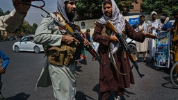 KABUL, AFGHANISTAN -- AUGUST 19, 2021: Taliban fighters mobilize to control a crowd rallying to raise the national flag of the Islamic Republic of Afghanistan during a rally for Independence Day at Pashtunistan Square in Kabul, Afghanistan, Thursday, Aug. 19, 2021.