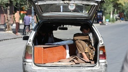 Relatives transport in a car the coffin of a victim of the August 26 twin suicide bombs, which killed scores of people including 13 US troops outside Kabul airport, in Kabul on August 27, 2021. (Photo by Aamir QURESHI / AFP) (Photo by AAMIR QURESHI/AFP via Getty Images)
